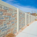 Concrete fence with stone precast and colors